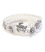 SEALIFE THEME MULTI PEARL LAYER STRETCH BRACELET - TURTLE