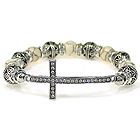 CRYSTAL CROSS AND METAL FILIGREE BALL LINK STRETCH BRACELET