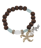 HANDMADE STARFISH CHARM AND WOOD AND FROST GLASS BEAD STRETCH BRACELET