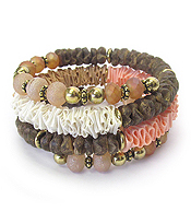 MULTI WOOD BEAD AND FABRIC MIX COIL BRACELET