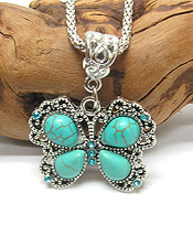 VINTAGE TIBETAN SILVER AND TURQUOISE BUTTERFLY NECKLACE