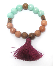 MULTI STONE AND WOODEN BALL TASSEL STRETCH BRACELET