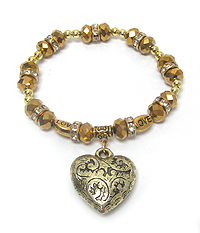 FACET BEAD AND PUFFY HEART CHARM STRETCH BRACELET