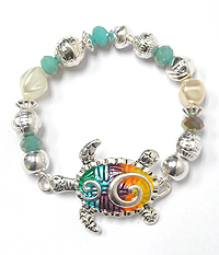 TEXTURED AND COLORED TURTLE STRETCH BRACELET