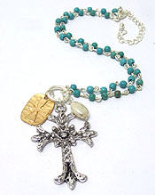 TEXTURED METAL CROSS WITH SMALL TURQUOISE STONES NECKLACE