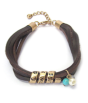 SWIRL METAL AND MULTI LEATHER BRACELET - FOLLOW YOUR BLISS